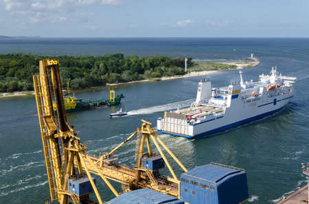 MARITIME TRANSPORT - A passenger ferry, a dredger and border guard boat in port channel