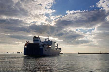 MERCHANT VESSEL - Ship sails from the seaport to sea 版權商用圖片