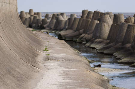 DOLOS AND BREAKWATER - Engineering structures protecting the port against sea waves