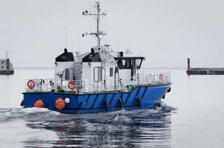 MODERN MOTORBOAT - The fast boat of the naval office is maneuvering in the seaport