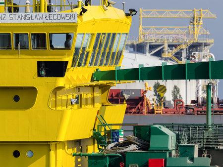 SWINOUJSCIE, WEST POMERANIAN - POLAND - 2020: Hopper dredger works on fairway in the port