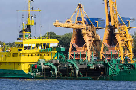 HOPPER DREDGER - A specialized vessel works on the fairway in the port