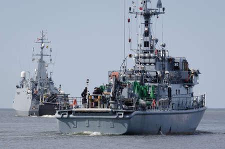WARSHIPS - Minehunters of Polish Navy sailing on the sea Standard-Bild