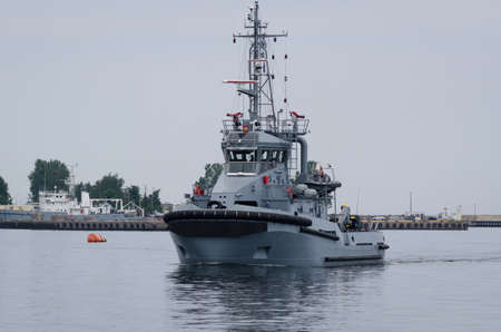 WARSHIP - A tugboat of Polish Navy is maneuvering in the port
