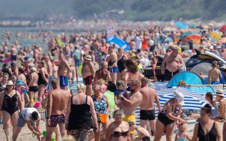 SARBINOWO, WEST POMERANIAN / POLAND - 2021: Holidaymakers relacreation on the sunny sea beach Editorial