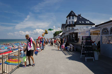 SARBINOWO, WEST POMERANIAN / POLAND - 2021: Holidaymakers are walking along the promenade Editorial