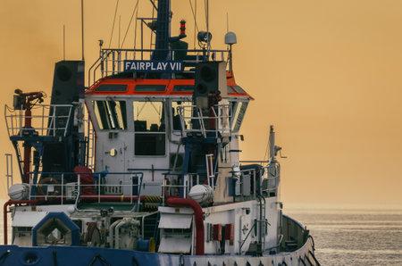 BALTIC SEA - 2021: Auxiliary ship sails on the sea at sunrise