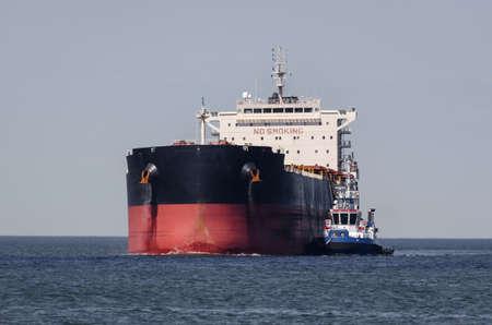 MARITIME TRANSPORT - Merchant vessel sail on waterway Standard-Bild