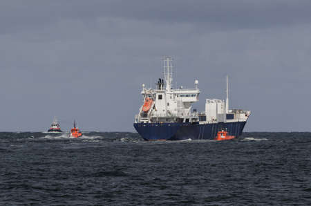 MARITIME TRANSPORT - Ship sails from the port to sea on a cruise Standard-Bild