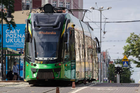POZNAN - POLAND - 2021: A modern tram goes through the streets of the city 新聞圖片