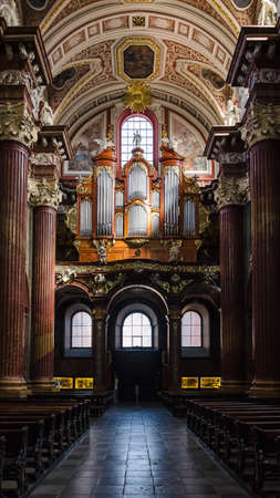 POZNAN - POLAND - 2021: The organ in the Collegiate Basilica of Our Lady of Perpetual Help
