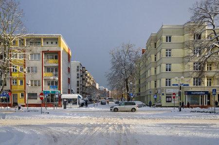 KOLOBRZEG, WEST POMERANIAN - POLAND - 2021: Traffic on the streets of a snow covered winter city