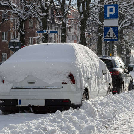 WINTER ATTACK IN THE CITY - Cars covered with snow
