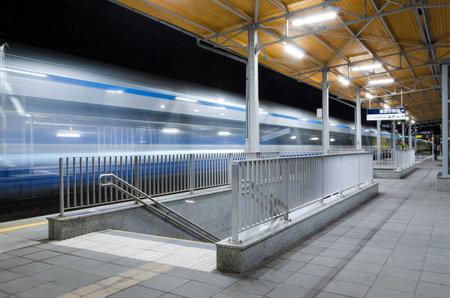 KOLOBRZEG, WEST POMERANIAN - POLAND - 2021: Train entry to the illuminated station platform