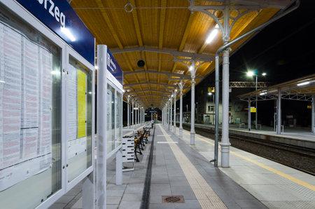 KOLOBRZEG, WEST POMERANIAN - POLAND - 2021: Illuminated train station platform