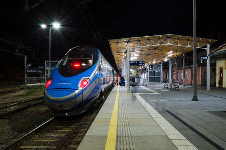 KOLOBRZEG, WEST POMERANIAN / POLAND - 2021: Express train waiting for passengers at platform at the railway station