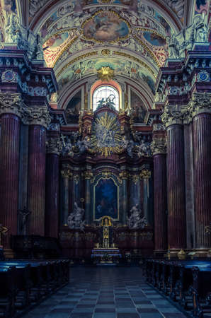 POZNAN - POLAND - 2021: Altar in the Collegiate Basilica of Our Lady of Perpetual Help