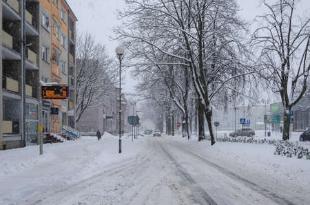 KOLOBRZEG, WEST POMERANIAN - POLAND - 2021: The city streets are covered with a thick layer of snow