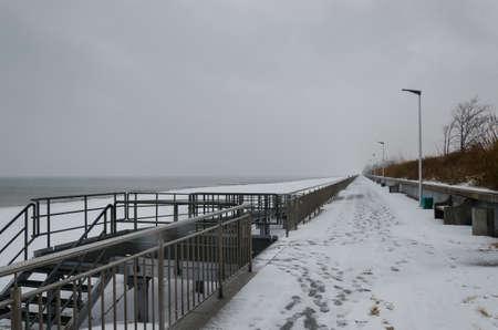 SEA COAST IN WINTER - Snowstorm on the promenade