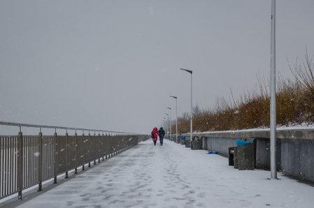 SEA COAST IN WINTER - Snowstorm over the seaside village