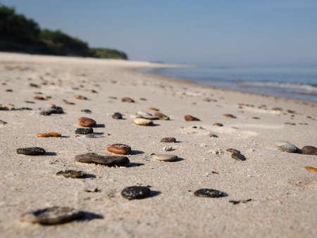 SEA COAST - Pebble stones on the beach