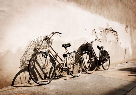 Italian old-style bicycles leaning against a wall