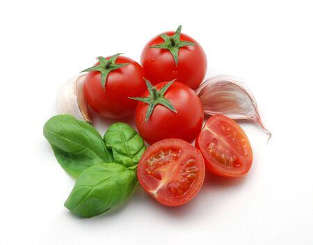Tomaten, bazielkruid en knoflook Stockfoto