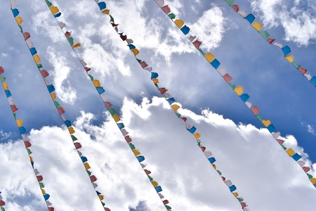 Prayer flags and clouds at the Shuangqiao Valley, Sichuan, China