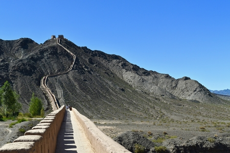 The ancient Great Wall from Ming Dynasty and the Gobi desert in Jiayuguan, Gansu province, China.