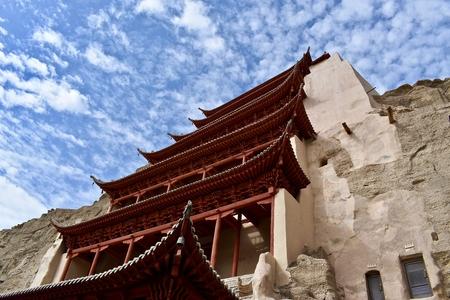 Grote Boeddha-tempel als onderdeel van Mogao-grotten (ook bekend als duizend Boeddha-grotten of grotten van de duizend Boeddha's) in Dunhuang, provincie Gansu in China Stockfoto
