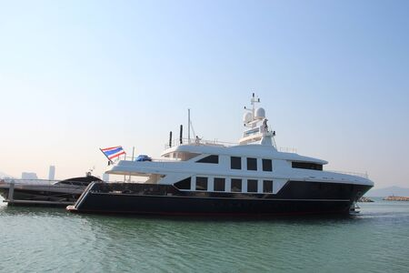 Big beautiful boat is at the pier in Thailand.