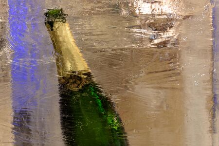 A bottle of expensive ice cream champagne in ice.