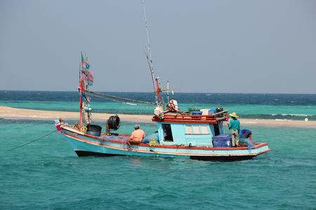 Fishing boat fishing in the open sea for a big fish. Stock Photo