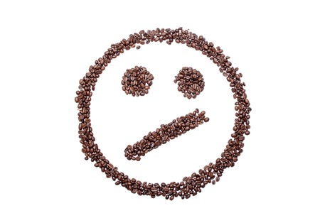 Irritated confused smiley of coffee beans isolated on white background. 版權商用圖片