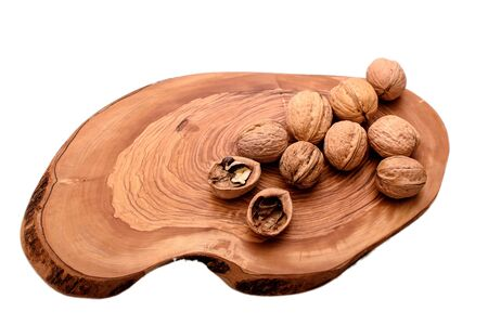 Walnut on wooden board isolated on white background.