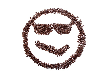 Malicious smile smiley coffee beans isolated on a white background. Standard-Bild