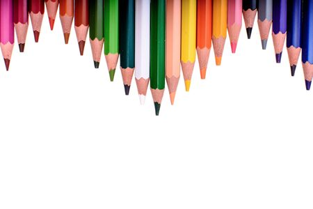 Many colored pencils isolated on white background, place for text. Stock Photo