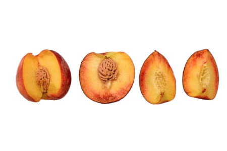 the transverse: Peaches whole and sliced halves with a bone isolated on white background. Stock Photo