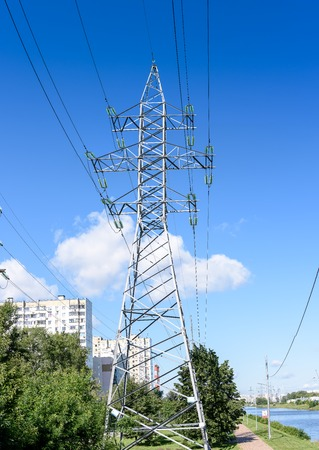 High-voltage supports with a view of the blue sky. Stock Photo