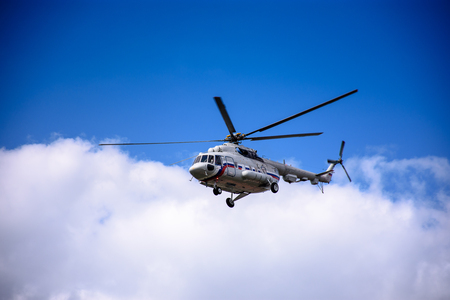 A large helicopter is flying in the blue sky Standard-Bild