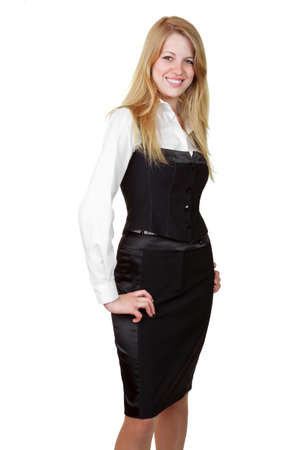 Portrait of a beautiful young business woman standing with hand on hip against white background photo