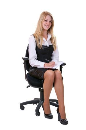 Junge lächelnde Geschäftsfrau über weißem Hintergrund Standard-Bild