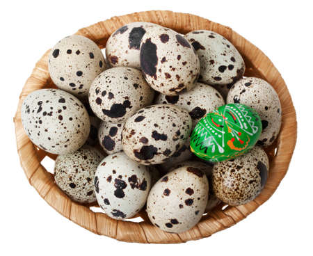 Easter egg in basket with eggs quail, isolated over white background Stock Photo - 12576537