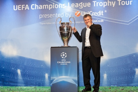 ambassador: KIEV,UKRAINE SEPTEMBER 30 :UEFA Champions League Trophy Tour 2011 in Kiev, Ukraine September 30,2011. Ambassador UEFA Davor Suker with Champions League Cup