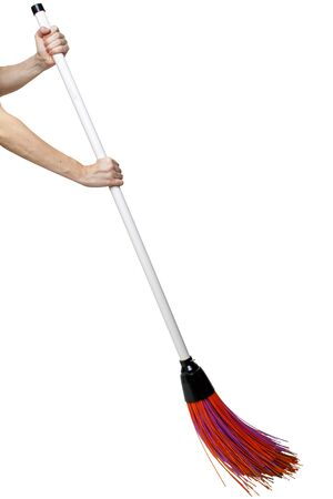 Hands holding broom isolated on white