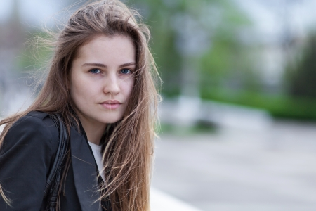 Closeup portrait pretty young woman outdoors photo