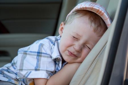 Sleeping Baby in Autositz Standard-Bild