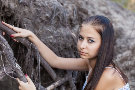 Portrait of sad young woman outdoors photo