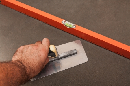 Concrete leveling, worker Stock Photo