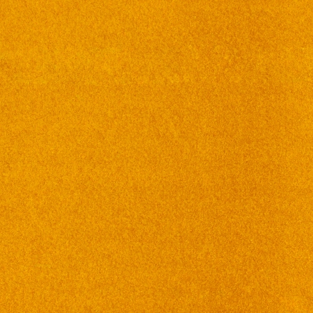 Abstract background with yellow texture, velvet fabric, full frame, close-up photo